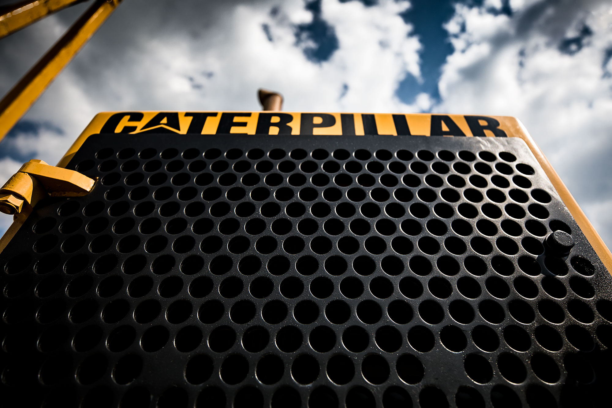The grill of a Caterpillar machine |  Scott Gable industrial photographer