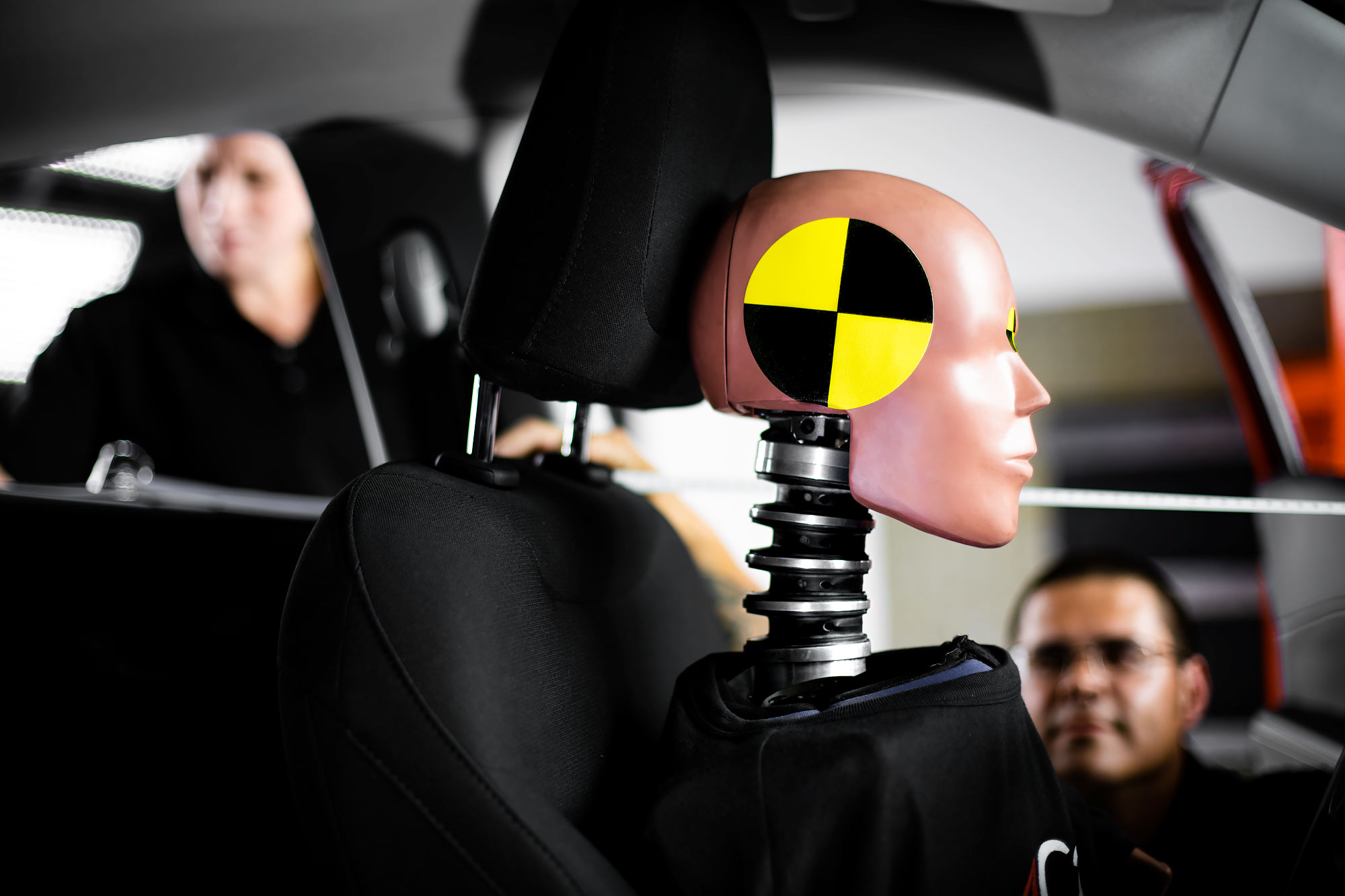 Profile of a crash test dummy with technicians in background |  Scott Gable industrial photographer