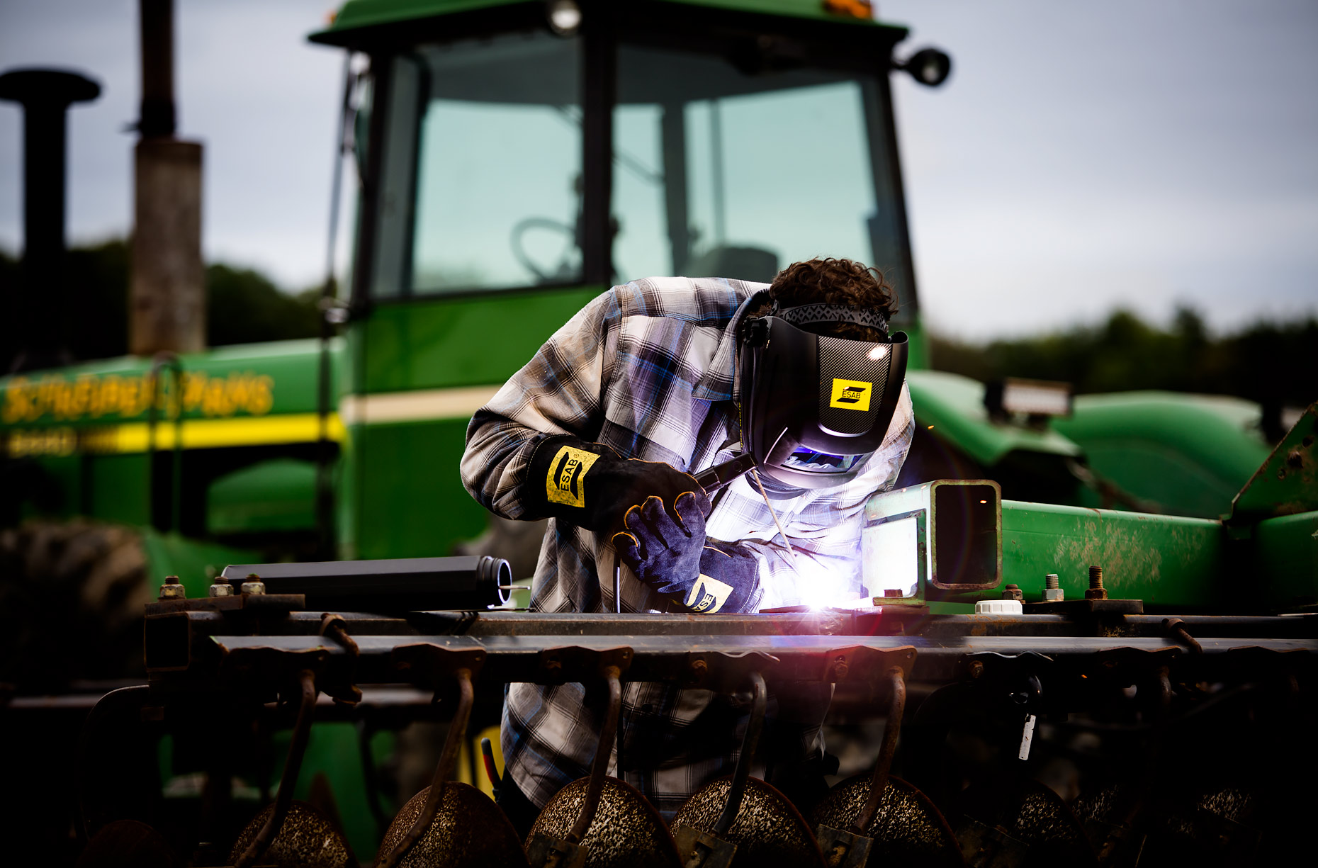 ESAB Rebel welder next to John Deere tractor in field |  Scott Gable industrial photographer
