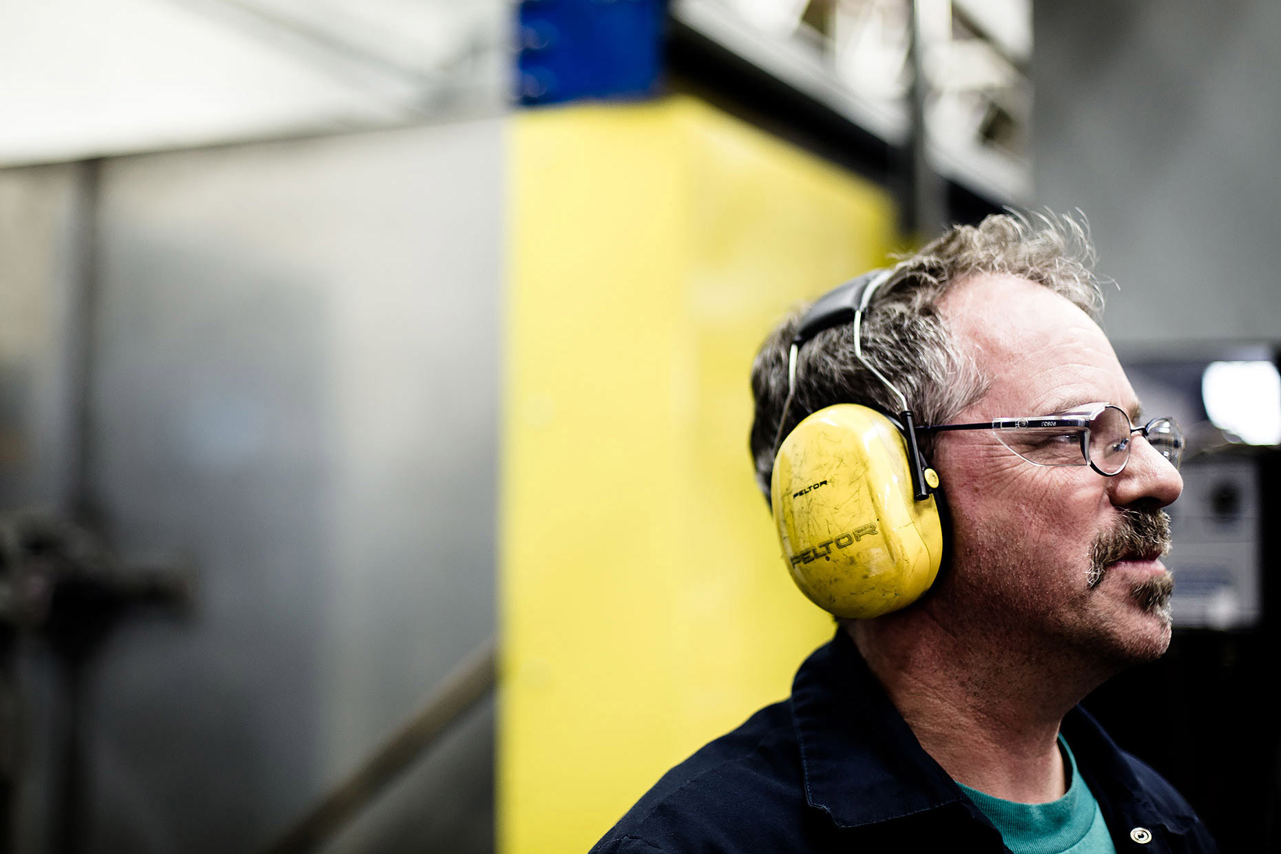 Industrial worker wearing ear protection | Scott Gable is an advertising and editorial photographer providing photography and video to corporate, industrial, healthcare, agriculture, and hi-tech clients worldwide.
