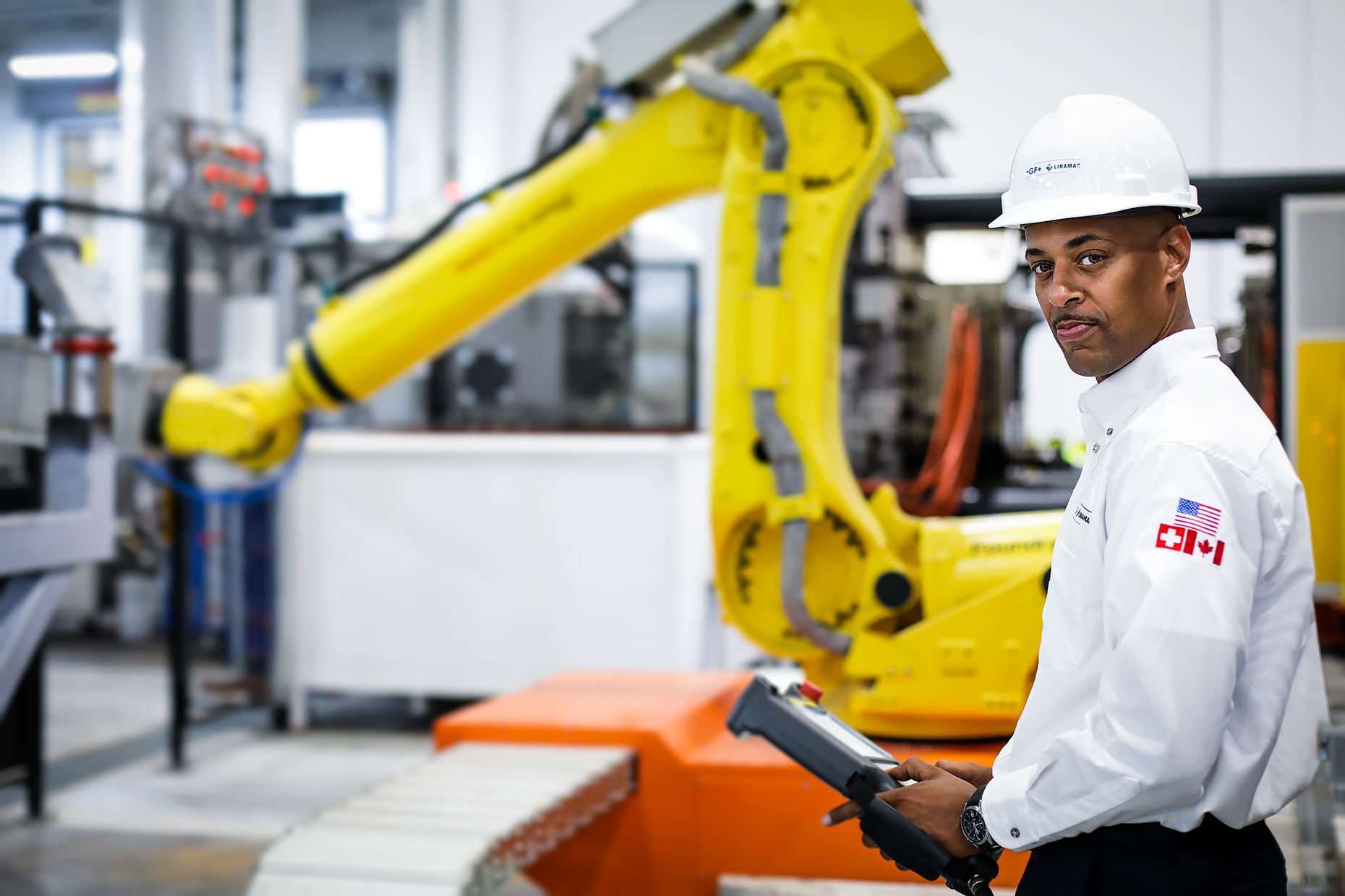 Engineer environmental portrait with robotic arm |  Scott Gable industrial photographer