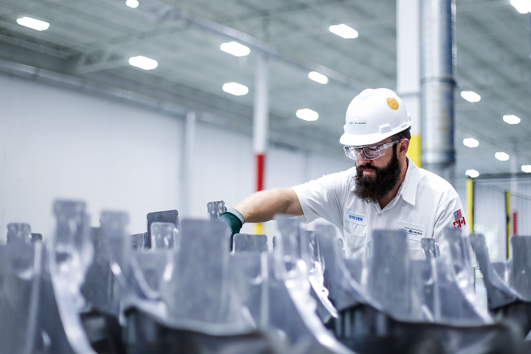 Factory technician with beard inspects product |  Scott Gable industrial photographer