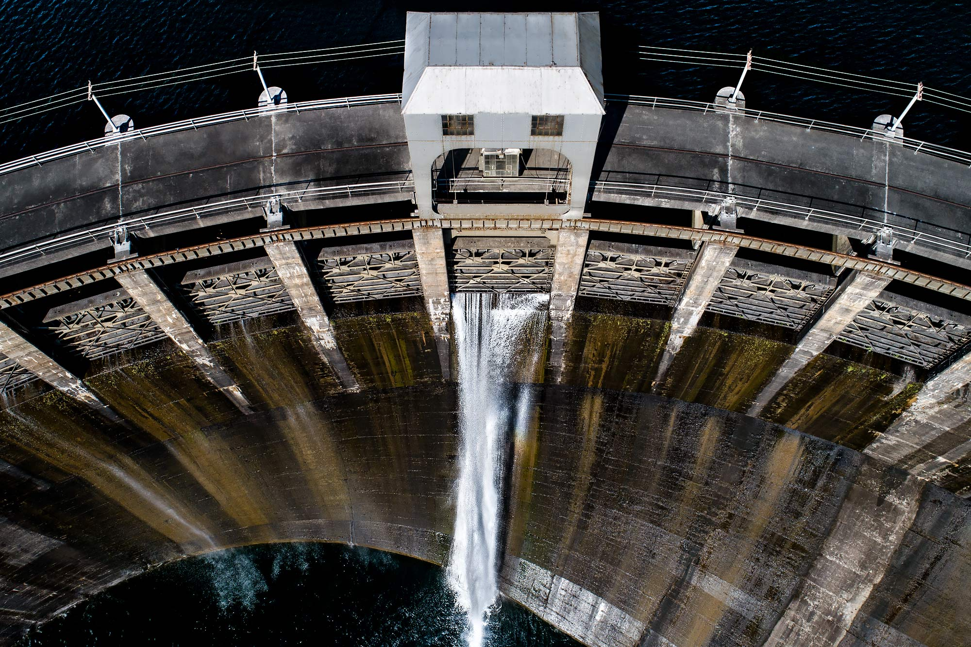 A close aerial shot of a hydroelectric dam with overflow gate opening |  Scott Gable industrial photographer