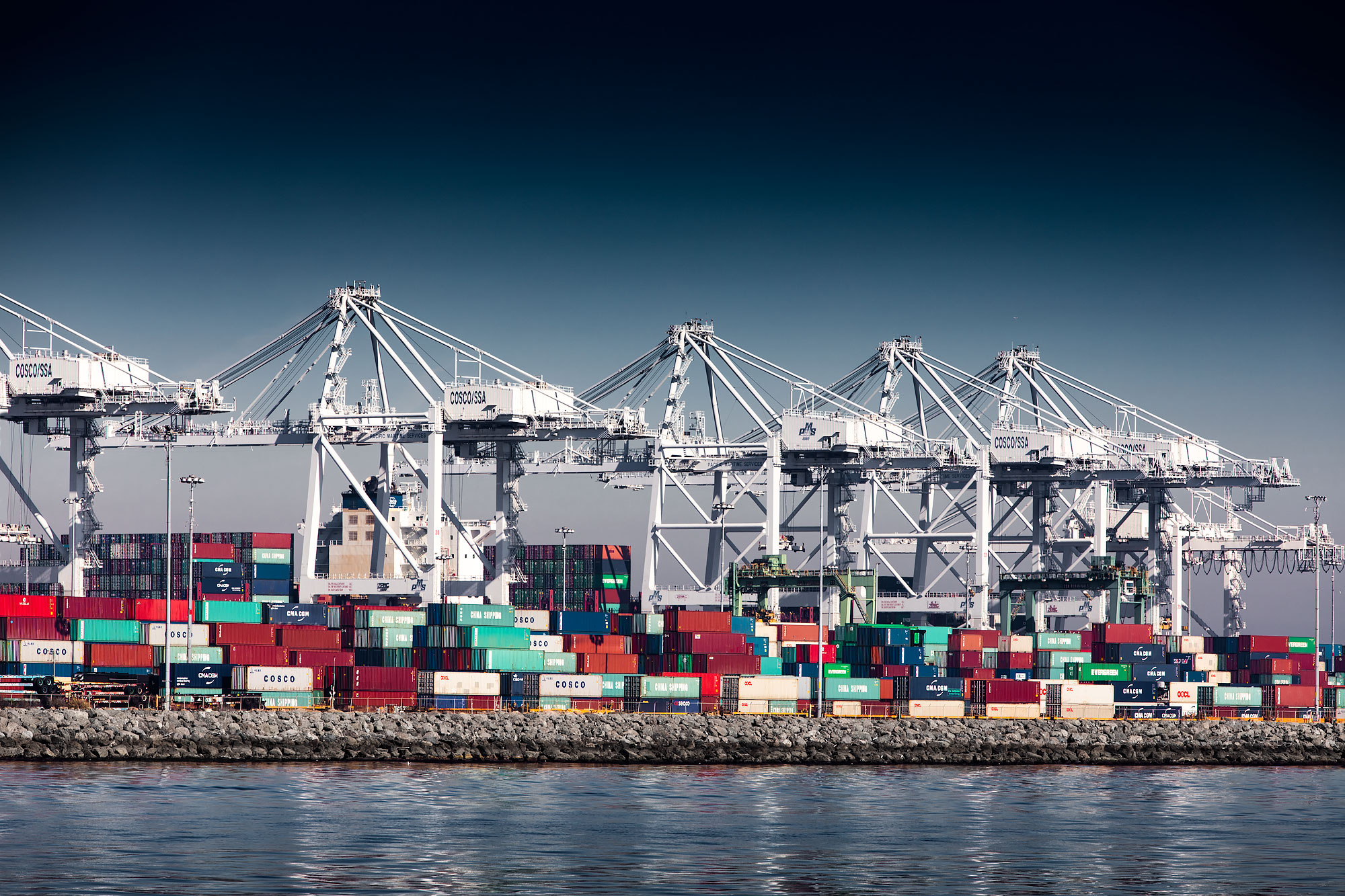 Cranes above shipping containers in the Port of Long Beach | Scott Gable industrial photographer