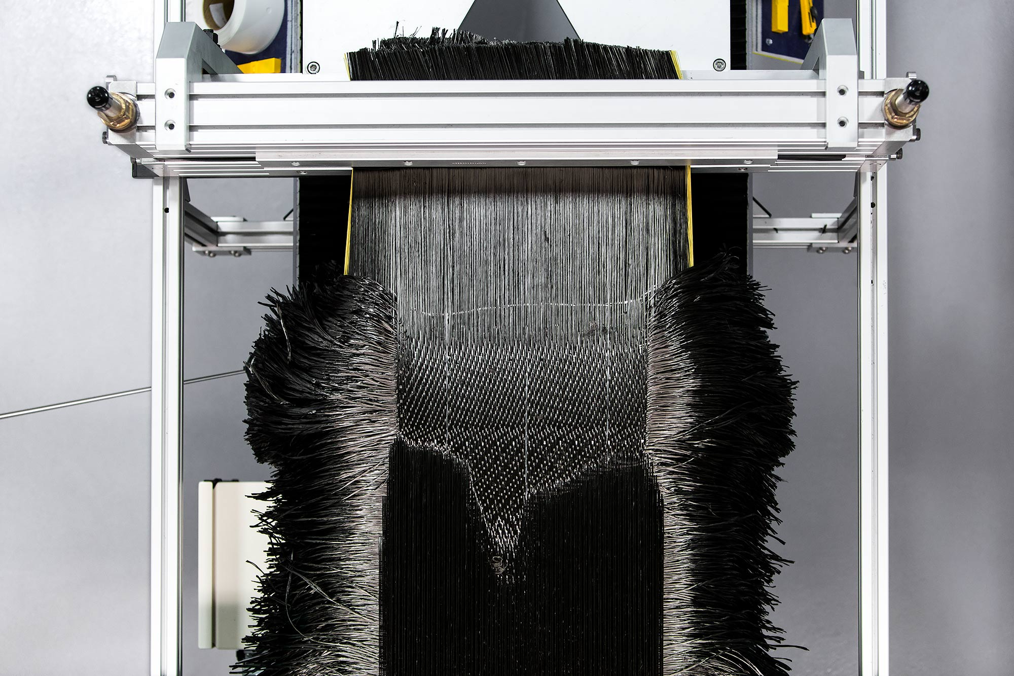 Carbon fiber loom weaving jet engine blade material | Scott Gable industrial photographer