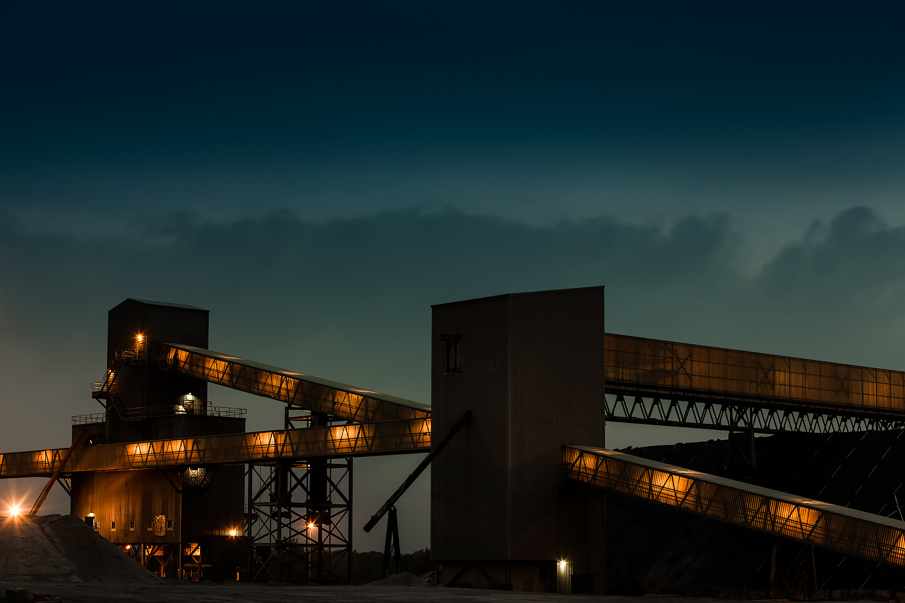 Salt refinery at night with chutes lit from within |  Scott Gable industrial photographer