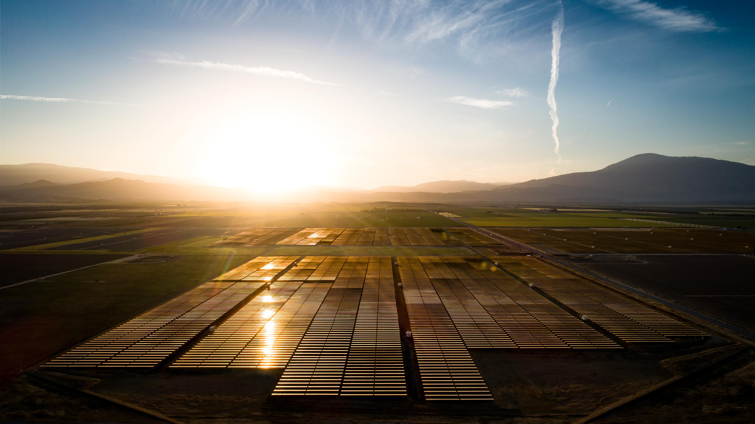 Aerial view of a solar array and surrounding fields at sunrise | Scott Gable industrial photographer