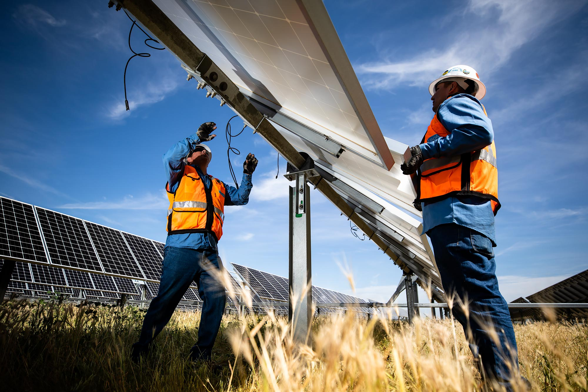 Two solar technicians replace a panel | Scott Gable industrial photographer
