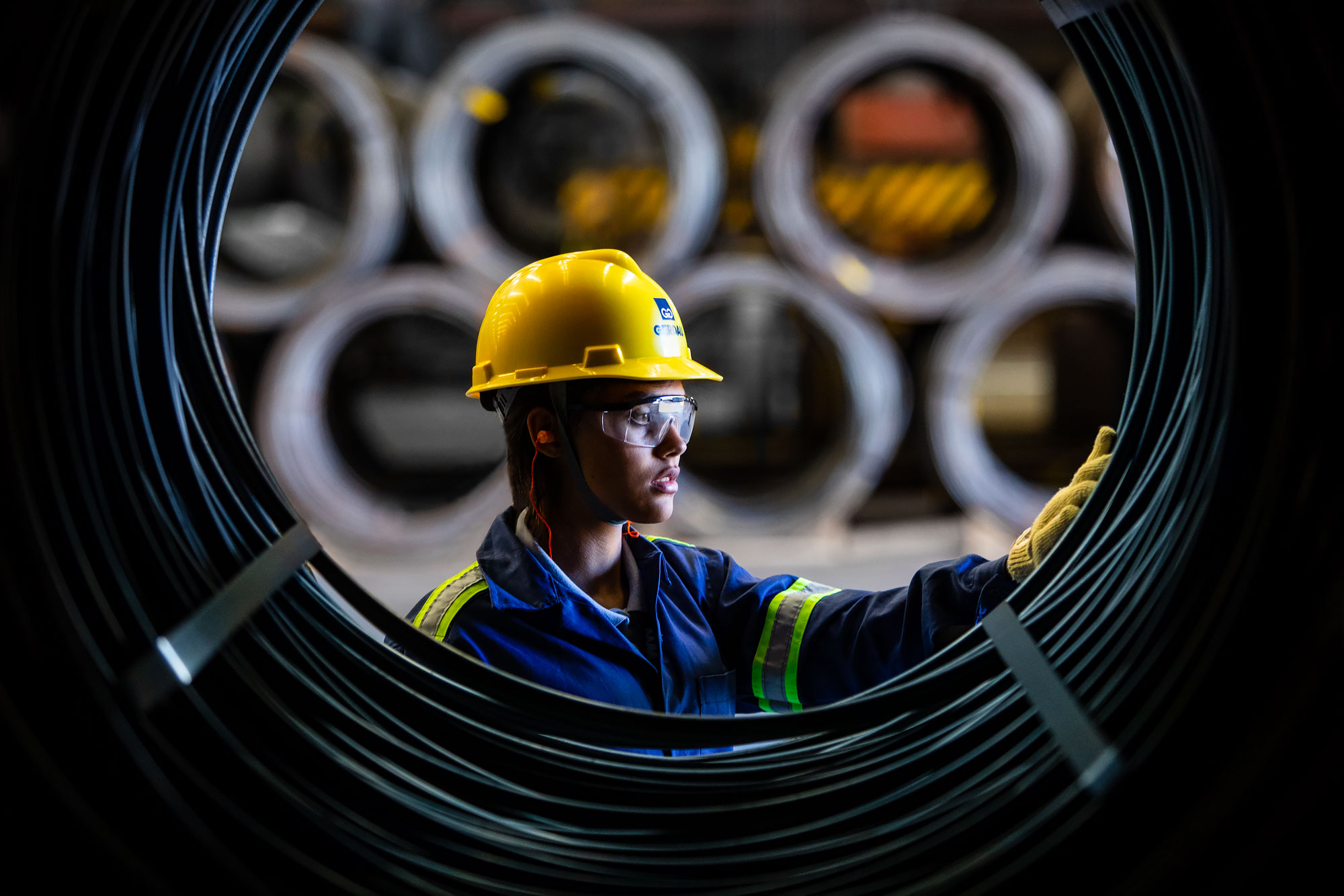 Inspector examines rolled steel wire |  Scott Gable industrial photographer