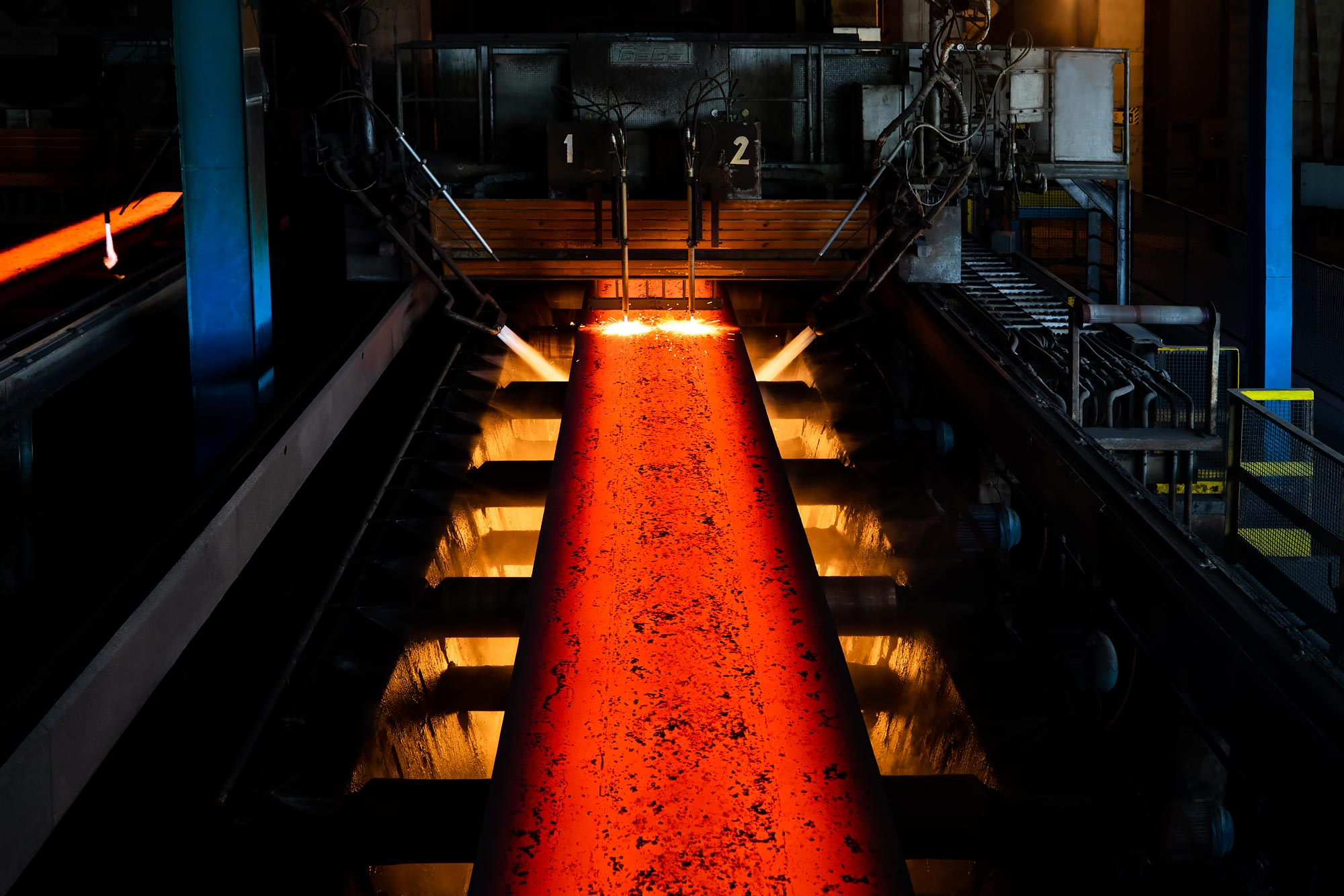 Slab steel coming from a hot rolling press | Scott Gable industrial photographer