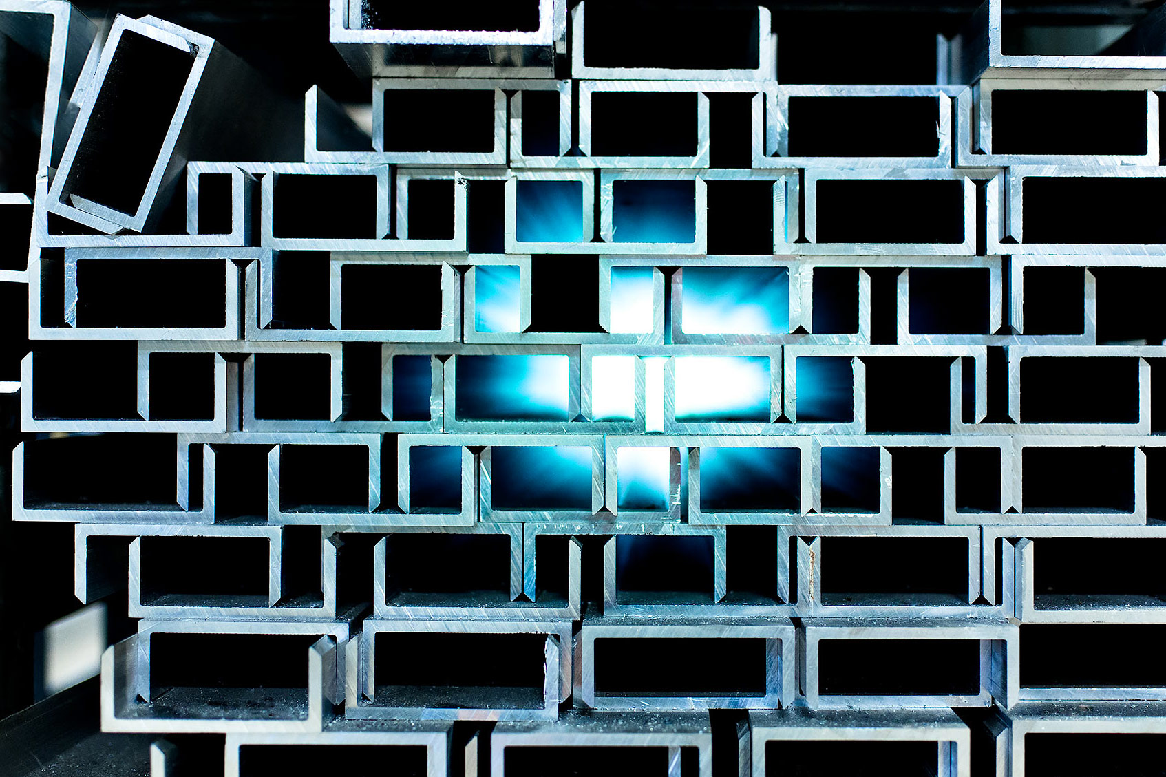 Close up of steel forms with blue light in back | Scott Gable industrial photographer