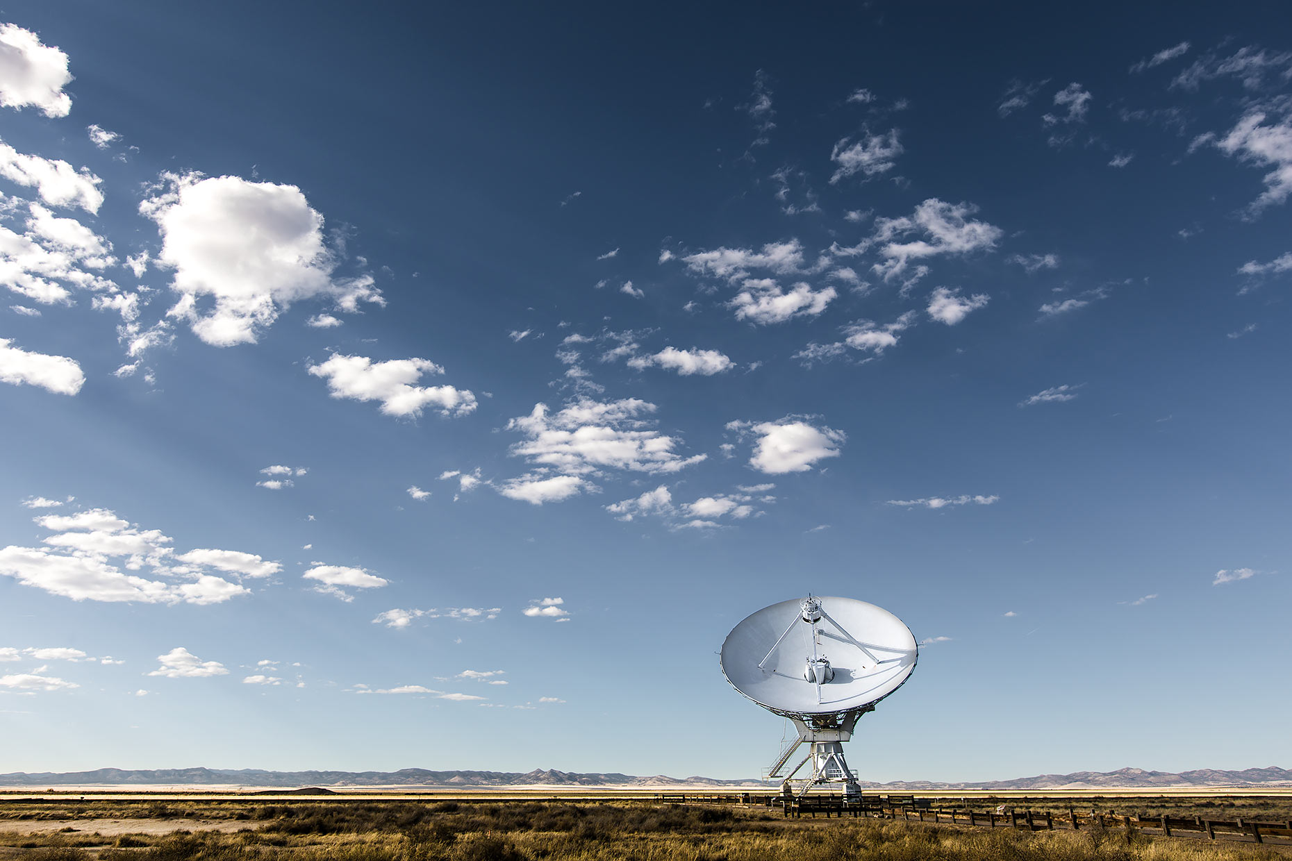 A radio antenna at the VLA with blue skies above |  Scott Gable industrial photographer
