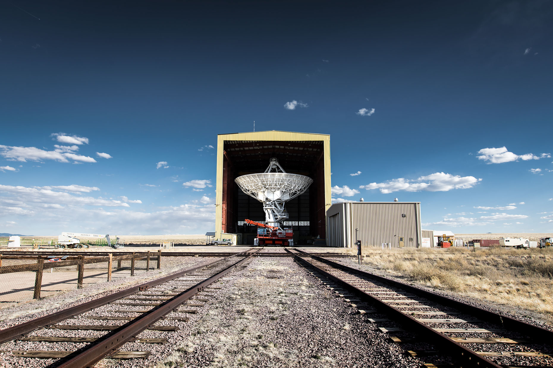 Radio antenna is moved from storage on tracks at the VLA |  Scott Gable industrial photographer