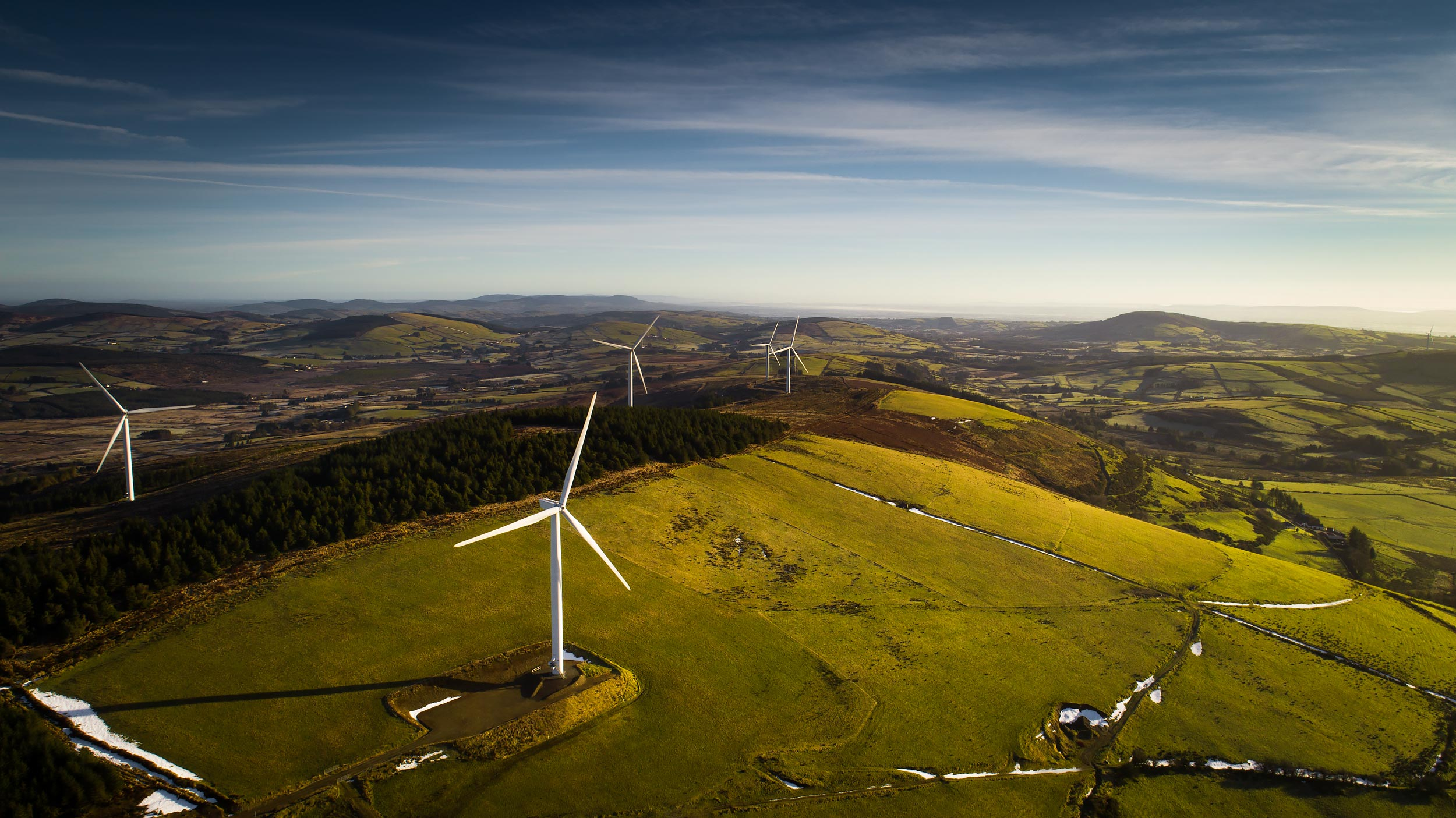Aerial view of wind turbines on rolling green hills | Scott Gable industrial photographer