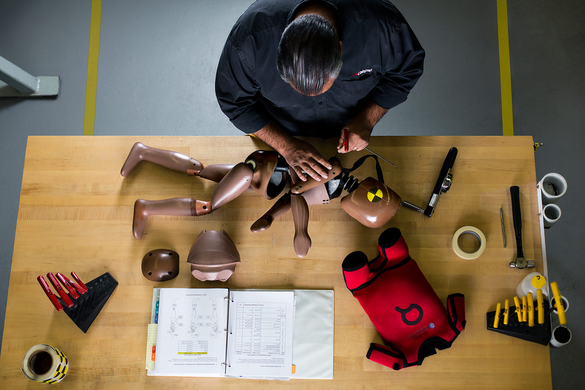 Aerial view of technician assembling a crash test dummy |  Scott Gable industrial photographer