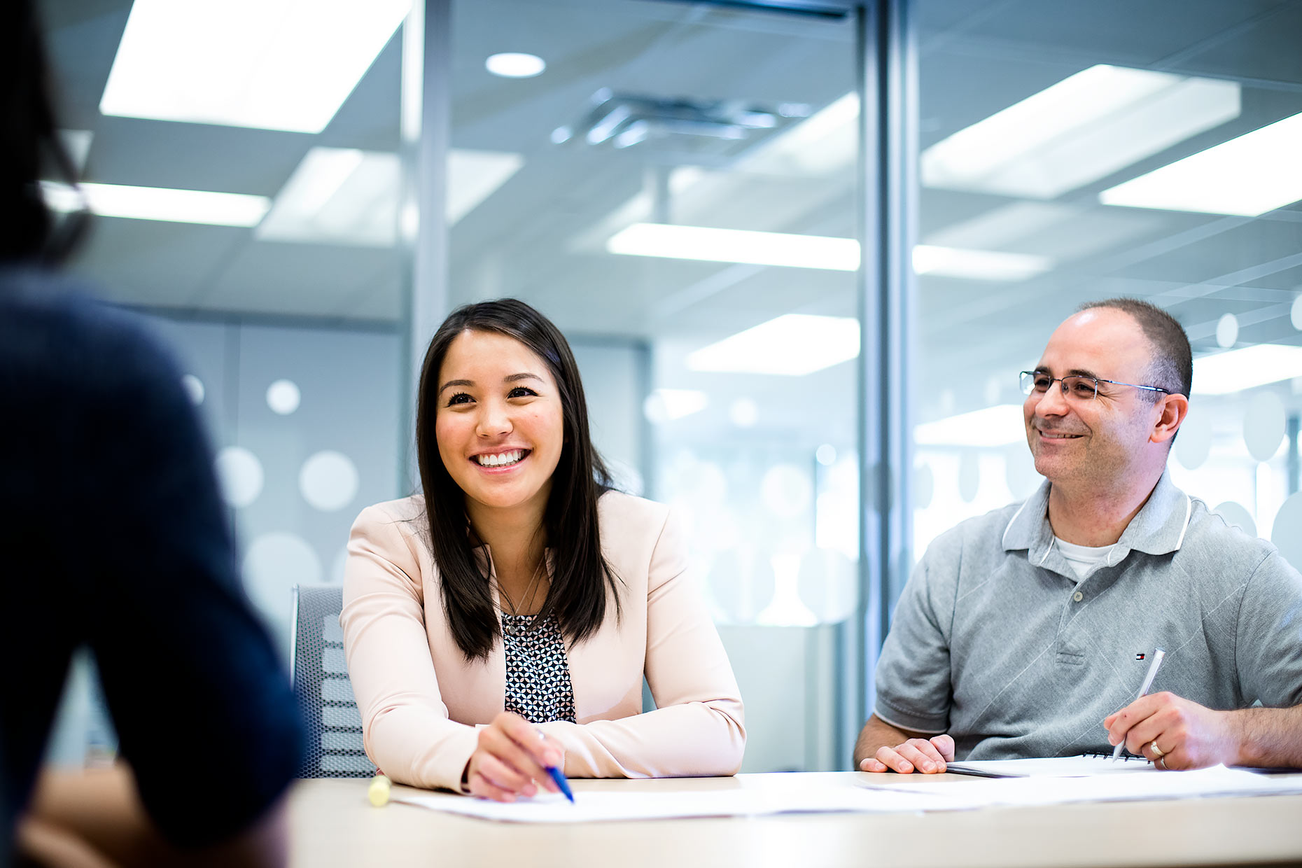 Smiling colleagues in a bright office meeting | Scott Gable industrial photographer