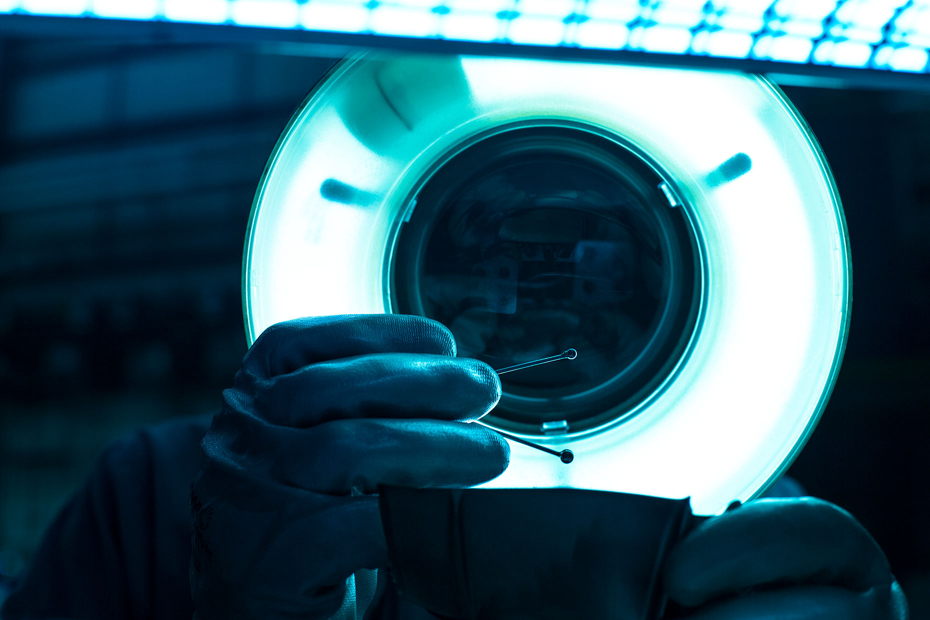 A technician inspects an instrument under LED magnifier | Scott Gable industrial photographer